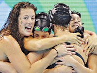 United States' Katie Ledecky (2nd-R) celebrates with her team-mates after winning the women's 4 x 200-metre freestyle relay final of the Rio 2016 Olympic Games on Thursday. — AP photo
