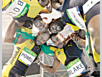 Jamaica's Asafa Powell, Yohan Blake, Nickel Ashmeade and Usain Bolt celebrate after winning gold medal in the men's 4x100-metre relay final of the Rio 2016 Olympic Games on Friday. — AP photo