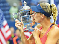 Angelique Kerber of Germany celebrates with the trophy after defeating Karolina Pliskova of the Czech Republic in the US Open women's final on Saturday. — Reuters photo