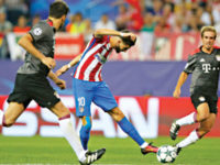 Atletico Madrid midfielder Yannick Carrasco (C) shoots to score his team's winning goal against Bayern Munich during their UEFA Champions League match at the Vicente Calderon stadium on Wednesday. — AP photo