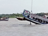The passenger launch, ML Oishi, is being salvaged by another ship on Thursday in the River Sandhya in Barisal. — New Age photo