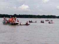 Fire service divers and locals continue search and rescue operation in the River Sandhya at Banaripara in Barisal on Wednesday after a launch capsized in the river. – Focusbangla photo