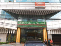 A file photo shows branches of Bangladesh Krishi Bank and BASIC Bank in a building in Dhaka. Burdened with huge amounts of defaulted loans, nine scheduled banks faced capital shortfalls of Tk 16,657 crore as of June 30 this year. — New Age photo