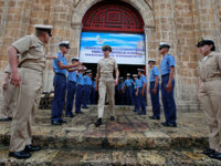 Members of the Colombian navy gather outside a church where President Juan Manuel Santos will attend mass on Monday, before signing a peace agreement with the Revolutionary Armed Forces of Colombia (FARC), in Cartagena, Colombia, September 25, 2016. — Reuters photo