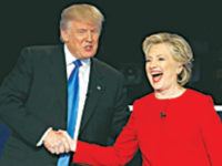 Republican US presidential nominee Donald Trump shakes hands with Democratic nominee Hillary Clinton after the debate at Hofstra University in New York on Monday. — Reuters photo