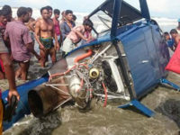 Locals crowd around the wreckage of the helicopter that crashed into Inani Beach at Ukhia in Cox's Bazar on Friday morning, leaving one person dead and three others injured. – New Age photo