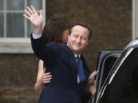 A file photo shows Britain's outgoing prime minister, David Cameron, with his wife Samantha, waves in front of number 10 Downing Street, on his last day in office as prime minister, in central London, Britain July 13, 2016.     REUTERS photo