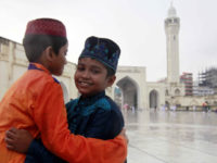 Two boys embrace each other celebrating Eid-ul-Azha on Tuesday. The photo was taken from Baitul Mukarram National Mosque in the capital. — Indrajit Ghosh