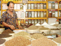 A file photo shows a spice trader waiting for customers at a shop in Dhaka. The Federation of Bangladesh Chambers of Commerce and Industry has again placed a set of demands related to value-added tax, customs duty and income tax to the finance minister for consideration.  — New Age photo