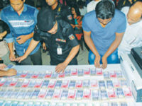 Counterfeit notes are put on display after law enforcers arrested five suspects, including a former bank official, with huge fake notes at Jurain and Banasree in Dhaka on Thursday. — Ali Hussain Mintu