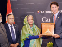 Bangladesh prime minister Sheikh Hasina confers 'Bangladesh Liberation War Honour' award posthumously on former Canadian prime minister Pierre Elliott Trudeau. Canada's incumbent prime minister Justin Trudeau, son of Pierre Trudeau, received the award at Hyatt Regency Montreal in Canada on Friday. — Focusbangla photo