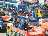 Goods-laden trucks with home-goers on board are stuck in a tailback at Chandra intersection in Gazipur for hours on Friday. — Ali Hussain Mintu