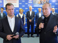 Russian president Vladimir Putin and prime minister and chairman of the United Russia party Dmitry Medvedev visit the party's campaign headquarters following a parliamentary election in Moscow, Russia, September 18, 2016. -- Reuters photo