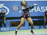 US tennis star Serena Williams hits a return against Simona Halep of Romania during their 2016 US Open women's singles match in New York on Wednesday. — AFP photo