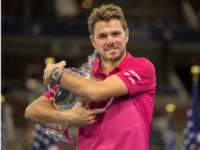 Stan Wawrinka of Switzerland poses with the trophy after he defeated Novak Djokovic of Serbia in the US Open men's final in New York on Sunday. – Reuters photo