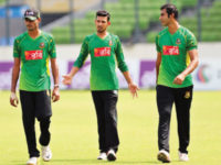 Bangladesh spinner Mosharraf Hossain (R) is seen with team-mates Nasir Hossain (C) and Shafiul Islam during a training session at the Sher-e-Bangla National Stadium on Thursday. — New Age photo