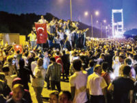 This file photo taken on July 15 shows people taking streets near the Fatih Sultan Mehmet bridge during clashes with military forces in Istanbul. — AFP photo
