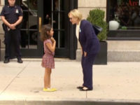 US Democratic presidential nominee Hillary Clinton greets a girl on the sidewalk after leaving her daughter Chelsea's home in New York, US September 11, 2016 in this still image taken from video. – Reuters photo