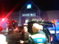 Medics wait to gain access to the Cascade Mall after three people were shot dead in Burlington, Washington, US September 24, 2016. -- Reuters photo